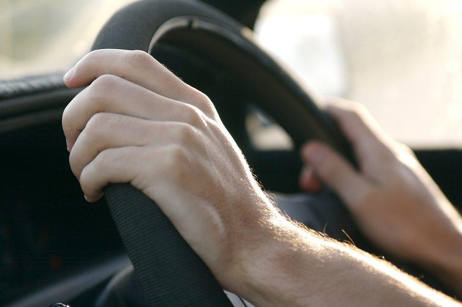 closeup driving a car