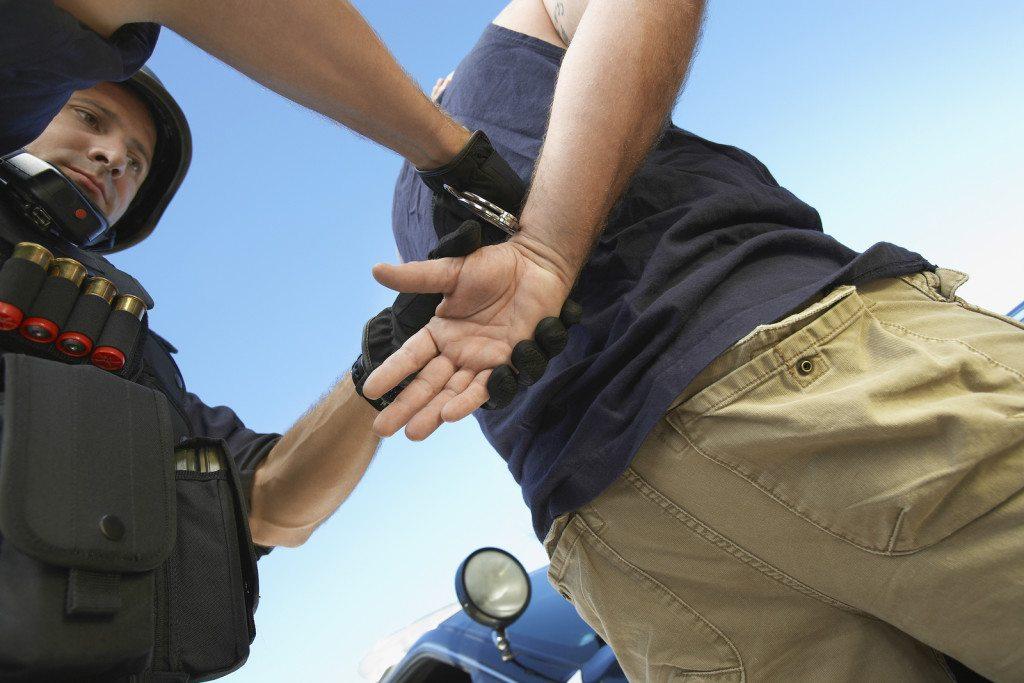 cop arrests young man